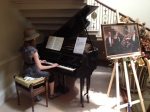 Playing piano in the entry way of Basildon Park; notice it from scenes in Downton Abbey?