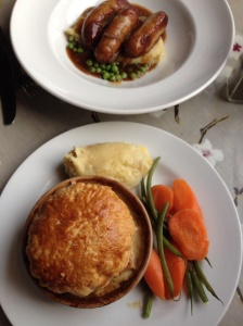"""Chicken & mushroom pie: five-star rating; the first and best savory pie of my stay in England. Above is """"bangers & mash,"""" sausages and mashed potatoes -- a traditional dish of my mom's choice."""