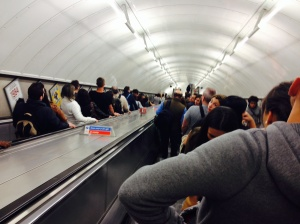 "An escalator for transfer on London's underground ""tube"" -- packed at 10:30 p.m. Friday night."