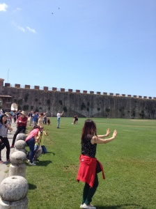 Human statues posing near the Leaning Tower of Pisa.